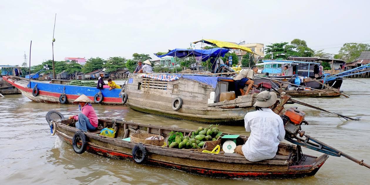 Marché flottant sur le delta du Mekong - Vietnam